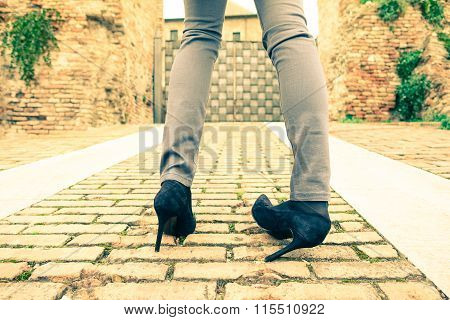 Woman Walking On High Heeled Shoes - Closeup Of Young Girl Legs With Twisted Ankle - Slim Teenager