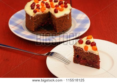 Yummy Chocolate Cake With Fresh Cranberries, Sea-buckthorn And Icing On Red Wooden Background