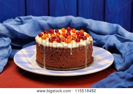 Chocolate Cake With Fresh Cranberries, Sea-buckthorn And Icing Decorated With Blue Cloth
