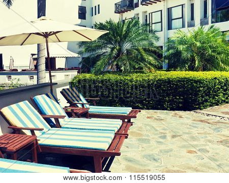 Sunbeds  At A Tropical Resort (toning)