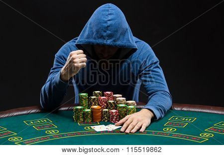 Portrait of a professional poker player sitting at pokers table