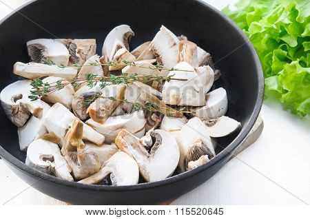Roasted Champignon Mushrooms With Thyme Branch In Pan On White Wooden Table