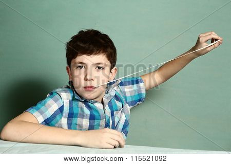 Boy Pull Chewing Gum With His Hand From Moth