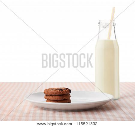 Chocolate Chip Cookies On White Plate And Bottle Of Milk