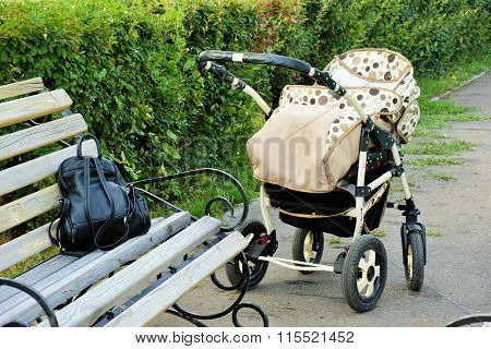 Baby stroller in the park in summer day