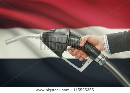 Fuel Pump Nozzle In Hand With National Flag On Background - Yemen