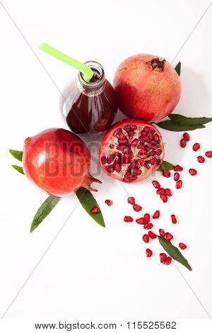 Isolated Pomegranate Juice With Pomegranate On White Background