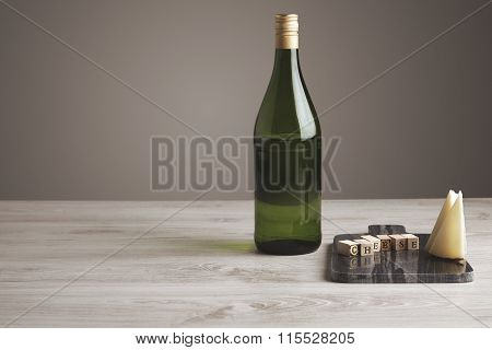 Wine Bottle With Letters And Cheese Side View