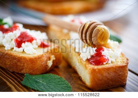 fried in batter toast with cream cheese and jam