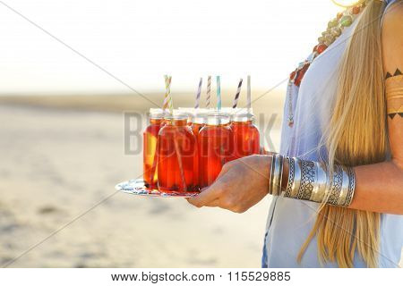 Happy Young Woman Holding A Dish With A Drinks At Summer Party