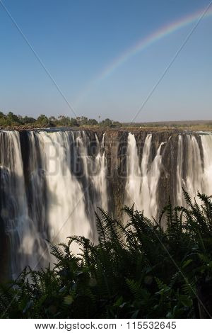 Victoria Falls in October with rainbow crossing