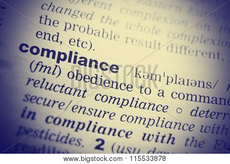 Definition of the word Compliance. Toned image