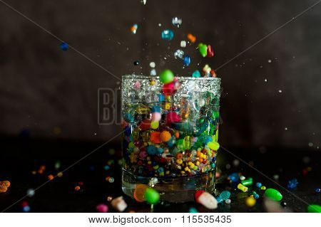 glass with water and beads