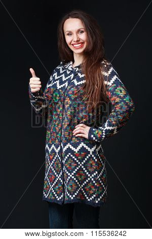 Young Brunette Woman In Bright Sweater Smiling, Showing Everything Is Great.