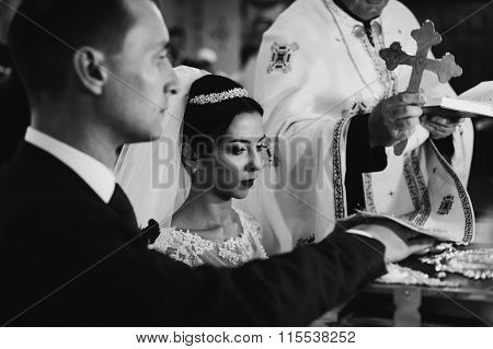 Sensual Emotional Bride And Groom Taking Vows At The Bible In Church Wedding Ceremony B&w