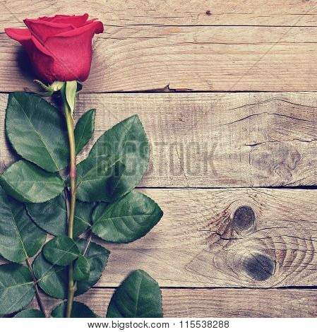 Red Rose In Retro Style On Old Wooden Background Top View