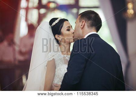Happy Newlywed Couple Dancing And Kissing At Wedding Reception Closeup