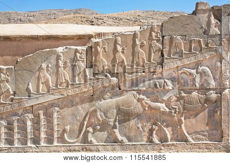 Bull And Lion Fighting On The Bas-relief Of Persepolis Palace Walls, Iran