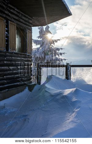 Wooden Chalet In Snowy Freezing Mountain