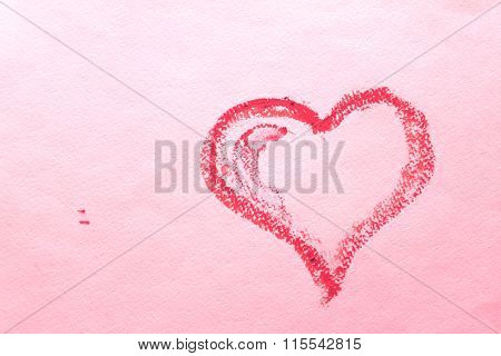Abstract heart on a pink sheet of paper.