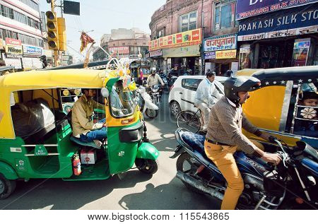 Many Private Yellow-green Rickshaw Cabs And Cars On The Street Traffic Jam In Indian Town