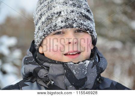 Portrait of frozen boy in winter