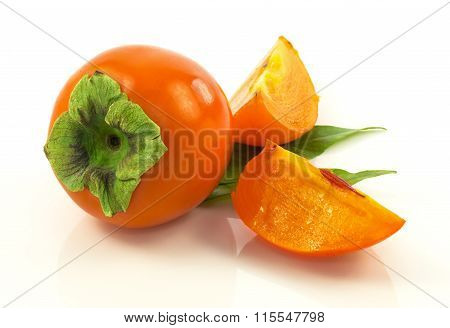 Ripe Fresh Persimmon With Slices And Leaves