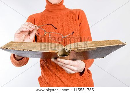 Hands Holding Book And Glasses