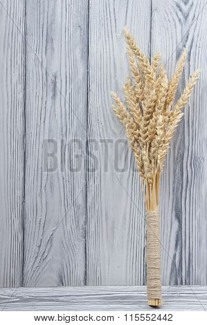 Sheaf of Wheat over Wood Background. Harvest concept.