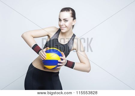 Sport And Fitness Concepts And Ideas. Professional Female Volleyball Athlete In Training Outfit Pose