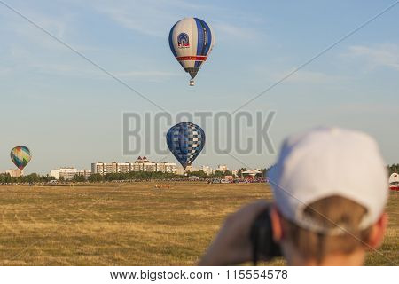 Man Watching At Air-Balloons Participating in International Aerostatics Cup Called 70 Years of Peace