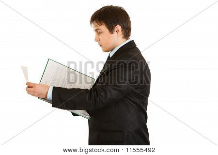 Serious modern businessman holding folder with documents in hand isolated on white