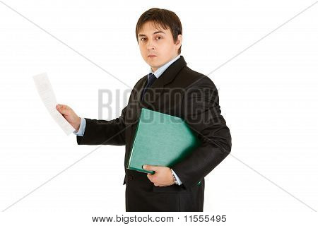 Serious modern businessman holding folder and exploring documents isolated on white