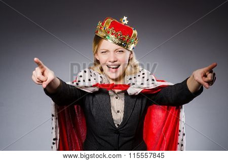 Pretty businesswoman with crown isolated on gray