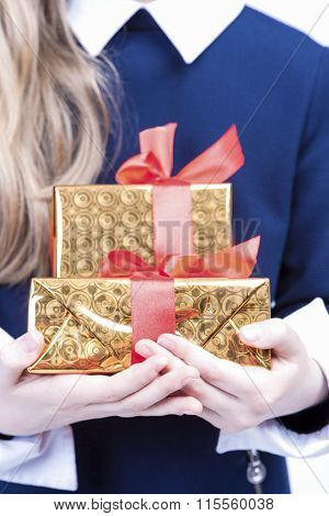 Closeup Of Hands Of Little Caucasian Girl With Christmas Present. Face Is Not Visible