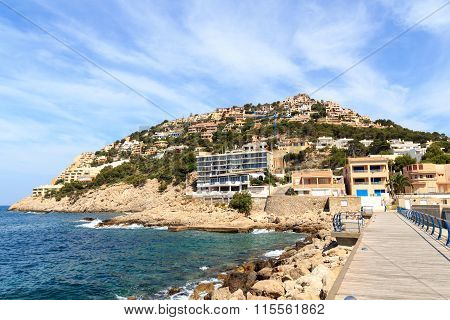 Hill with houses in Port d'Andratx and Mediterranean Sea, Majorca Spain