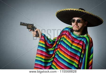 Mexican with gun wearing sombrero