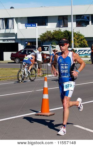 Runner strides out in half ironman event.