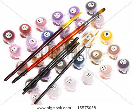 set of paints to paint in small jars and brushes