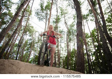 Pretty Sportive Girl  On A Bicycle To Prepare For Descent.
