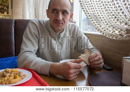 Man Eats In The Dining Room