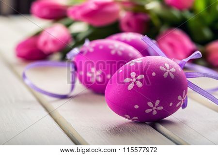 Happy easter. Multicolored spring tulips and Easter eggs. Spring and Easter decorations