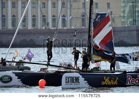 ST. PETERSBURG, RUSSIA - AUGUST 23, 2015: Catamaran of Red Bull Sailing Team of Austria before the last day of St. Petersburg stage of Extreme Sailing Series. The Wave Muscat team leading after 3 days