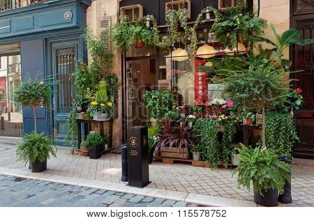 BORDEAUX, FRANCE - JUNE 27, 2013: Flower shop in the historical center of the city. The historical part of the city is a UNESCO world heritage site
