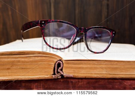 Vintage Reading Glasses On The Book