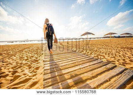 Woman walking on the sandy beach