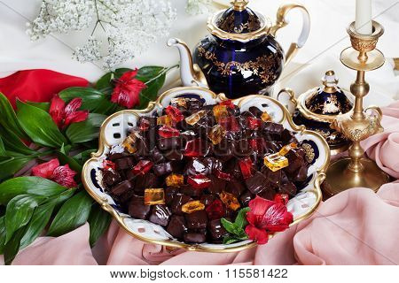 beautiful jelly candies in chocolate on a porcelain dish provence palace utensils still life, luxury