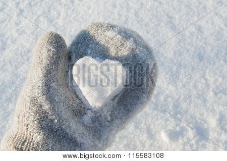 Snow heart in hand