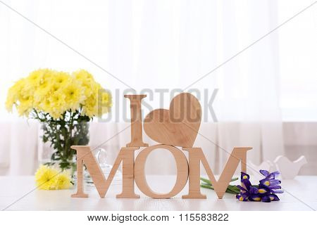 Wooden decoration with flowers in front of the window