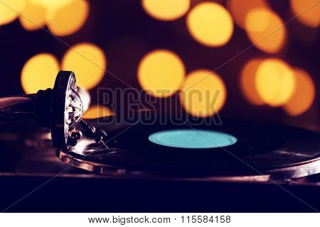 Gramophone on bright blurred background